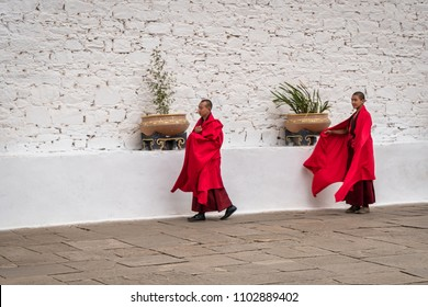 Paro, Bhutan - March 29, 2018 : Monks in a hurry to go to prayer, inside the Paro Dzong