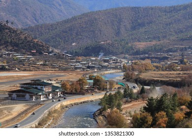 PARO, BHUTAN -NOV 28 : View of the densely packed dwellings on the banks of river Paro Chu on November 28, 2018 in Thimphu, Bhutan. Paro is the second largest city In Bhutan