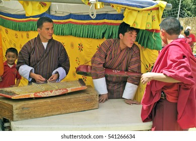PARO, BHUTAN - SEPTEMBER 18: Unidentified musicians with traditional instruments by religious festivity, on September 18, 2007 in Paro, Bhutan