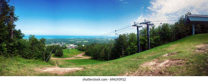 Paroramic view of summer landscape above Blue Mountain Ski Resort with a chairlift in Collingwood, Ontario