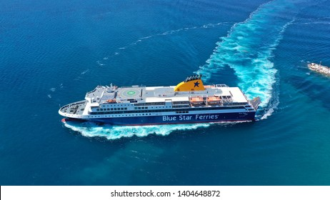 Paros, Cyclades /Greece - May 18 2019: Aerial drone photo from Blue Star Naxos passenger ferry reaching port of Paros island