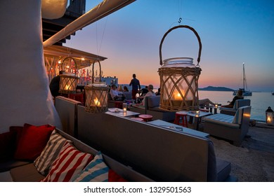 PAROS, GRECE - JUNE 2017: Romantic scenery at the picturesque village of Naousa in the island of Paros Cyclades. Its one of the most popular tourist destinations in Greece in summer days
