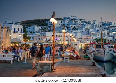 PAROS, GREECE - JUNE 2017: Scenic view of Naousa town and the port at sunset. Naousa is a picturesque village located in the northeastern corner of the island of Paros, Cyclades, Greece, Europe