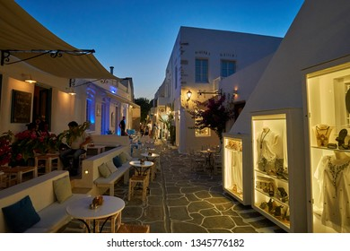 PAROS ISLAND GRECE, JUNE 2017:  Night scene over the picturesque narrow streets of Naousa village in the island of Paros Cyclades. Its one of the most popular tourist destinations in Greece in summer