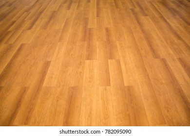 Parquet flooring is arranged in a long and clean line.