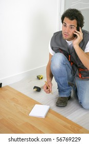 Parquet layer on phone sitting on the floor