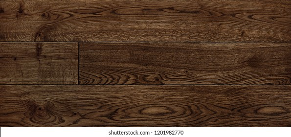parquet from solid wood. sample of parquet. texture or background. wood texture. board. painted with natural oil. wax. mastic. imitation of valuable species of wood.