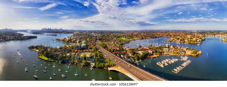 Parramatta river in Sydney west flowing from western suburbs to Sydney harbour and city CBD. Aerial view from Gladesville bridge to Drummoyne with lots of marine yachts.