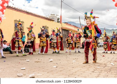 Parramos, Guatemala - December 29, 2016: Traditional folk dancers in Spanish conquistador masks & costumes perform Dance of the Moors in village near UNESCO World Heritage Site of Antigua.