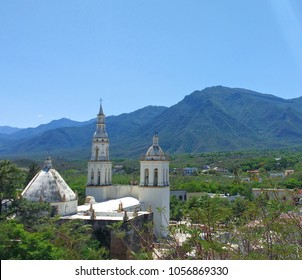 Parroquia Santiago Apostol Church in the Pueblo Magico of Santiago, Nuevo Leon Mexico with the Sierra Madre Oriental mountains in the background.