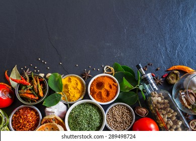 (Parsley, Chili, Turmeric) Group of indian spices and herbs difference ware on stone background with top view and copy space for design foods, vegetable, spices, herbs or other your content.