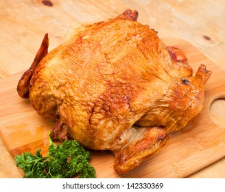 Parsley next to a chicken that has been smoked