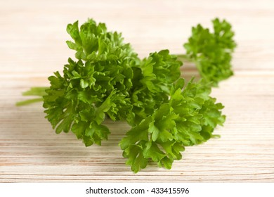 parsley on a wooden background