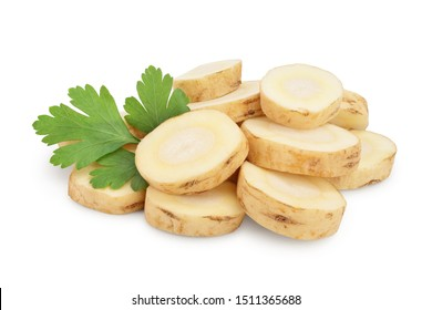 Parsnip root slices with parsley isolated on white background closeup