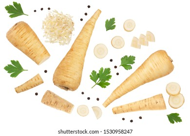 Parsnip root and slices with parsley peppercorns isolated on white background closeup. Top view. Flat lay