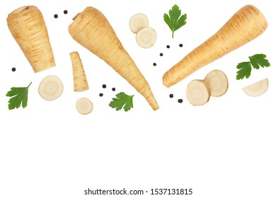 Parsnip root and slices with parsley peppercorns isolated on white background with copy space for your text. Top view. Flat lay,
