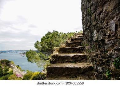 Part of an abrupt ladder of fortress of Rumeli Hisari aspiring into sky. At a background Bosphorus and Bosphorus Bridge.