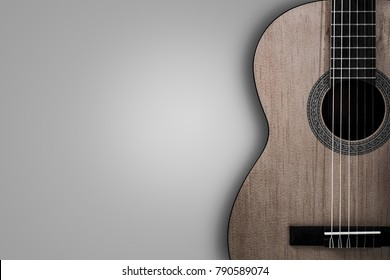 Part of an acoustic guitar on a grey background.