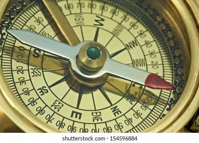 Part of antique bronze compass.