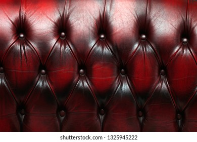 Part of an antique red sofa as a background