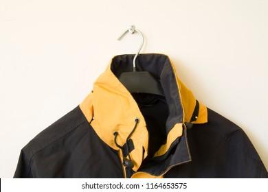part of an autumn jacket on a hanger close up