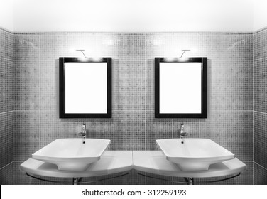 Part of bathroom showing symmetrical two sinks with mirrors and lamps in black and white dynamic shadings.