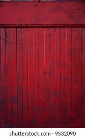 part of a battered red door