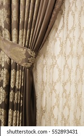 Part Of Beautifully Draped Curtain On The Window In Room Close Up Piled