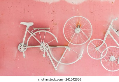 Part of bicycle hang on pink wall background