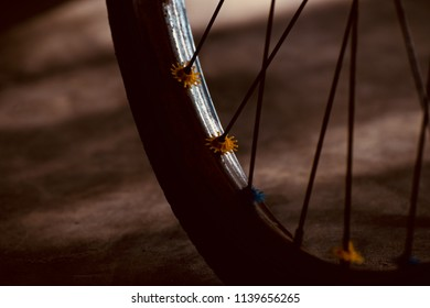 A part of a bicycle wheel with metallic sporks isolated unique photo