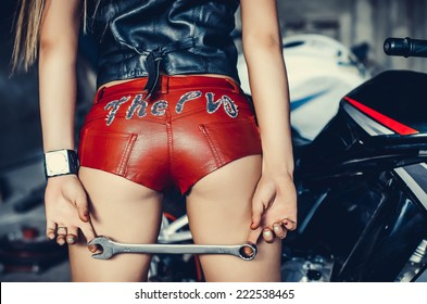 Part of the Biker girl in a leather Shorts.
