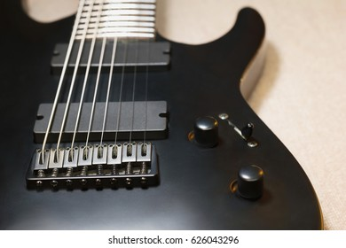 Part of black eight string electric guitar