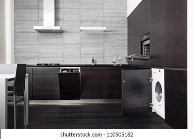 Part of black hardwood kitchen with build-in domestic technique