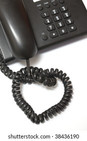 part of black phone and cord of telephone in heart format
