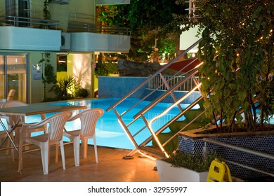 Part of blue swimming pool in the evening. Natural lighting without processing