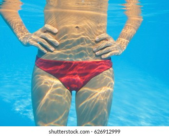 part of the body beautiful slender woman under water in the pool