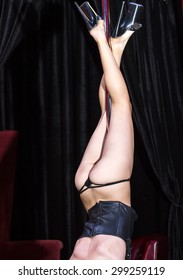 part of the body of the girl dancing striptease