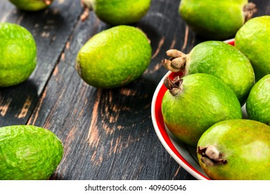 Part of the bowl Feijoa fruits with scattered fruit on the table
