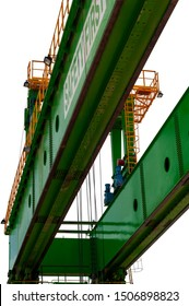 Part of the bridge crane shot from below, Fragment details of a gantry green crane. Isolated on white background.