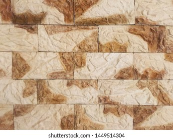 Part of a brown stone wall. Background and texture. Can be used in the interior. Close-up.