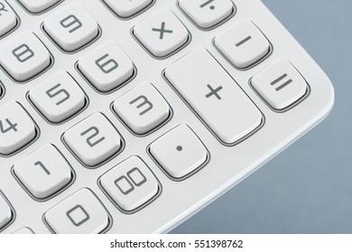 Part of calculator on a blue backgorund - studio closeup