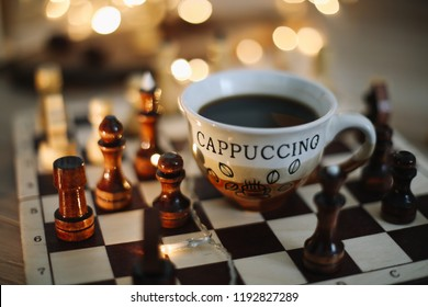 Part of chess table with coffee cup