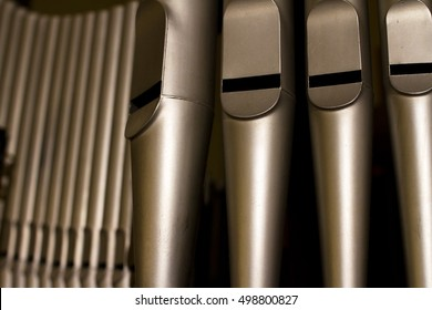 part of the church organ with many air pipes made of metal