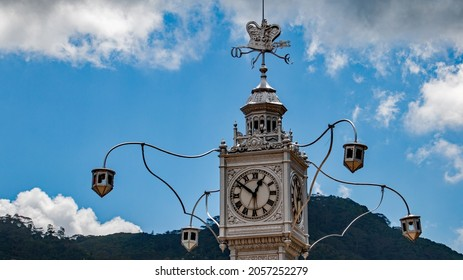 A part of the clock tower in the centre of Victoria , Mahe Seychelles on a sunny day with some clouds
