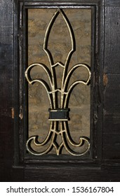 part of the coat of arms of Trinity College Oxford University taken in St Giles' at the kitchen entrance to the college with the fleur-de-lis or fleurs-de-lys state symbol of Louisiana
