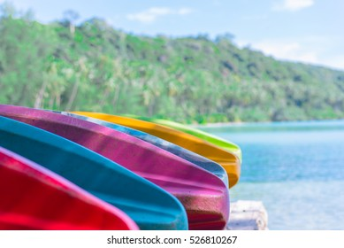 Part of colorful kayak on Palm trees in tropical perfect beach at Koh Kood , Thailand