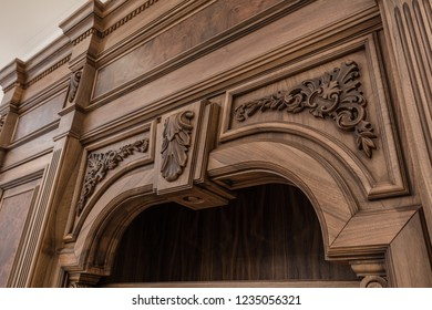 Part of the cupboard with handmade wood carving close up