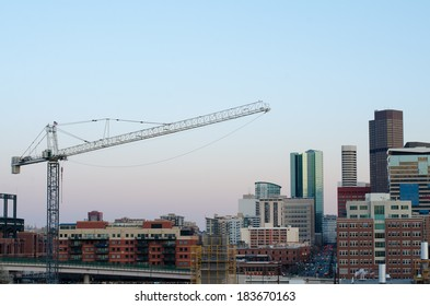 Part of the Denver skyline with a crane, taken from the 7th floor of a nearby apartment building.