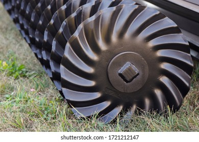Part and detail of agricultural disk harrow. Modern technology in agriculture concept