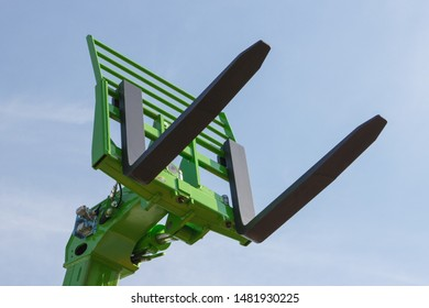 Part and detail of forklift loader or stacker. Modern technology in industry or agriculture concept